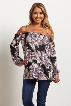 Show some shoulder in this fabulous floral maternity top! This top features an open shoulder with cami straps to give a feminine touch. Style this top with some maternity flare jeans, wedges, and a floppy hat to get the complete boho chic look.