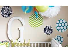 DIY nursery decals using fabric and spray adhesive- cut any shapes you want and create your own for cheap