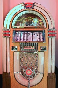 Id want a pretty pink jukebox in the living room . Listening to retro rock music