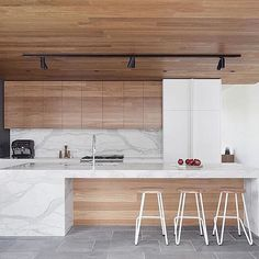 Bluestone, Blackbutt Timber and Calacutta Marble Kitchen by @bowerarchitecture Photography by @shannonmcgrath7 #estliving
