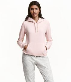 Light pink. Top in soft velour with a jersey-lined drawstring hood, kangaroo pocket, and ribbing at cuffs and hem.