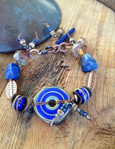 Hey, I found this really awesome Etsy listing at https://www.etsy.com/ru/listing/210668151/lapis-blue-lampwork-bracelet-lampwork