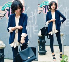 white ruffly dress with navy blue blazer, black wedges