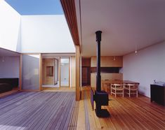 Takaharu Tezuka. The combination of the wood structure and the open sky makes it feel like you're living outside