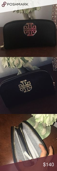 Tory Burch pebbled leather wallet clutch black Beautiful black leather wallet by Tory Burch. Never used ✨ cute to carry as a little clutch also :) (no tags but plastic is still on emblem and inside wallet ) 100 percent Authentic guaranteed  goes great with the Tory Burch satchel I have for sale ☺️ bundle and save Tory Burch Bags Wallets