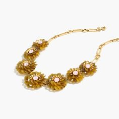 "Brighten up with a glittering zinnia-inspired necklace. <ul><li>Length: 18 1/2"" with a 2 1/4"" extender chain for adjustable length.</li><li>Zinc, epoxy beads, glass stones, brass.</li><li>Light gold ox, shiny 14k gold plating.</li><li>Import.</li></ul>"