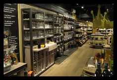 "The culinary ""boutique shop"" concept of OIL & VINEGAR brings together a wide range of international food and cooking products, all designed to please the senses and are presented in alluring, Mediterranean-style surroundings. At OIL & VINEGAR, customers are referred to as ""guests"", and the guests are invited to smell, taste, and touch products before purchasing. The retail philosophy revolves around three key aspects of a consumer visit: Experience, Service, and Taste."