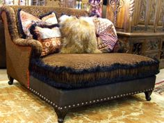 This is the Shalamar Mahogany chair chaise shown with drop-dead gorgeous fabric and trim. The Tibetian sheep pillow adds that WOW factor.  Please call Brumbaugh's for additional information and pricing. 817-244-9377