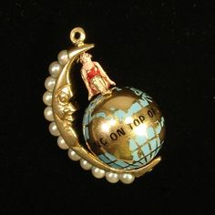 Sitting on top of the world gold, enamel, and pearls globe