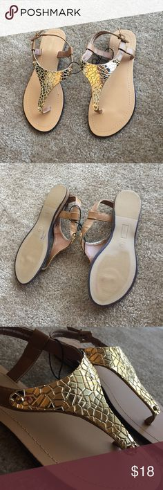 Sandals Brand new. Flexible, gold plated front. If you have any questions,