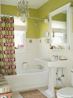 Raise the ceiling visually. A wall of color above shoulder-height tile draws the eye upward, increasing the perceived space. Create the illusion of more space overhead by installing crown molding at the ceiling and painting it the same color -- one that is a lighter shade or color than your walls