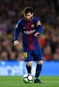 Lionel Messi of FC Barcelona runs with the ball during the La Liga match between Barcelona and Real Madrid at Camp Nou on May 6, 2018 in Barcelona, Spain.