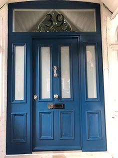 Blue Victorian front door with 2 side panels and fan light. To explore our range please visit www.cerberusdoors.co.uk
