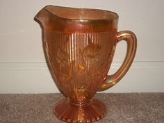 """Iris Herringbone Jeanette Glass Marigold Carnival Glass Pitcher 9""""  I collect this pattern."""