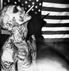 Rick genest, aka zombie guy. & that is not make up.....he's tattoo from head to toe...