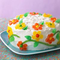 Flower Power Cake Recipe - ingredients: 2-layer-size package lemon cake mix, 1 16 ounce can white frosting. Small gumdrops, Candy-coated fruit-flavored pieces, Sour fruit-flavored straw candy. How pretty is this!!?? Mother's Day, birthdays, showers or just because!!