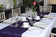 Classic purple on white, perfect for a dinner event. One of the many colour schemes available to hire in our range of table linen, chair covers, sashes & bows.