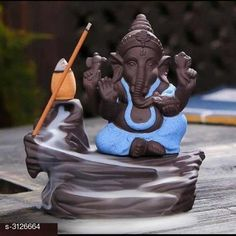 Religious Idols & Paintings Budha Ceramic Smokey Fog Fountain Gift Material: Ceramic Size: L x W - 5 in x 3 in Description: It Has 1 Piece Of Ganesh Statue (5 Cones Free) Country of Origin: India Sizes Available: Free Size   Catalog Rating: ★3.9 (1472)  Catalog Name: Elite Budha Ceramic Smokey Fog Fountain Gifts Vol 8 CatalogID_428950 C128-SC1316 Code: 471-3126664-903