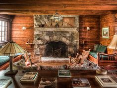 Nab J.P. Morgan's Adirondack Great Camp for $3.25M.Lee Fontaine rockers in background.