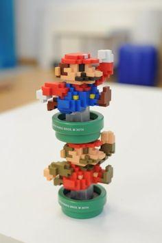 Pixel Mario amiibo figures