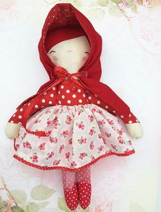 Handmade Little Red Riding Hool. Cotton exterior with polyester fill and felt hair with cotton braids. Face stitched for added safety. Doll has
