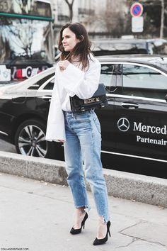 A bell-sleeved shirt layered over a turtleneck and slouchy jeans transforms a basic outfit to chic as seen at PFW on Collage Vintage.