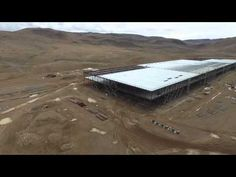 """Tesla Gigafactory - Sunday 05/17/2015 Drone Flyover - 1/4 size pilot plant - a prioritized construction phase to allow battery production to begin in 2016, not 2017 as originally scheduled, according to spokeswoman Khobi Brooklyn, in order """"to begin producing batteries as soon as possible.""""  See video edited with new music and added text, embedded in an article reporting on it at: http://www.bloomberg.com/news/articles/2015-05-22/drone-captures-tesla-s-new-gigafactory-in-stunning-hd-video"""