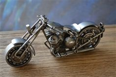 This is an amazing hand made Motorcycle in the Harley Fat-Boy style! It has an enormous amount of detail and moving ball barring wheels! This is a true piece of art which at the moment is limited to 2 pieces!