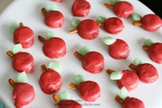 mini oreos dipped in red candy melts, green airheads cut & shaped as leaves, pretzel sticks for stems--so fun!!  Use a toothpick to dip then remove once it's dry