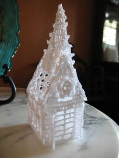Crochet  would be pretty with battery tea light in it on window sill with added parchment paper lining.