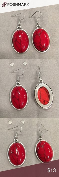 """Pierced Earrings silver tone and red tone Pierced Earrings silver tone and red tone.  Approximately 1"""" long x 3/4"""" wide.  Dangles down approximately 1 3/4""""    Never worn. Jewelry Earrings"""