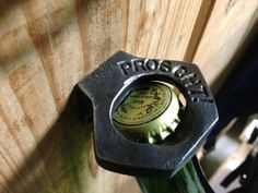 Personalized Geometric Hand Forged Wall Mounted Bottle Opener via Etsy