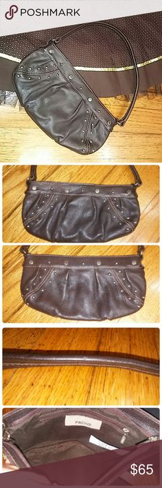 """Genuine Prune Bovine Leather Small Bag Reasonable offers always considered on items over $15. Occasionally on items under $15. Bundle deals available!! Don't miss this little shoulder bag!  Pretty Prune Argentinean Bovine Leather purse. Pretty dark brown leather, silver stud accents. Used condition. A couple very light scuffs in the letter, so light they seemed to blend in well. Some pulling in the stitching for the inside lining. Other than that, still looks like a great purse! 9.5"""" width…"""