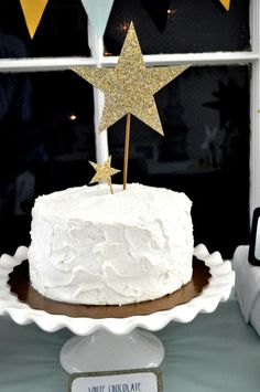 A homemade cake was glammed up with glittered star toppers.