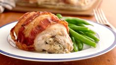 Make these easy stuffed chicken breasts wrapped in bacon for a special weeknight meal.