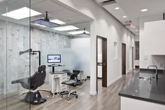 Tasios Orthodontics - Treatment Hall - Frosted glass instead of walls give a very open feel