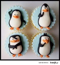The Madagascar penguins- Just smile and wave, boys....