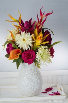 Use faux flowers to put together your own lovely arrangement of flowers for Mother's Day.