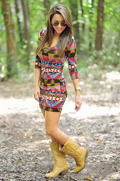 What an amazingly cute outfit!! I love the pattern of the dress! Not big on the boots tho