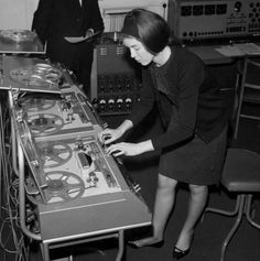 Delia Derbyshire at the controls of her tape recorders in her prime.