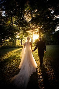 Love the sunlight in this romantic outdoor wedding photo of the bride and groom