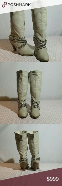 Not Rated heeled boots sz 8 Not Rated Women's slip on boots sz 8. They are an off-white color, very stylish! These shoes are in good used condition. Please look at the photos closely to judge condition for yourself. Not Rated Shoes Combat & Moto Boots