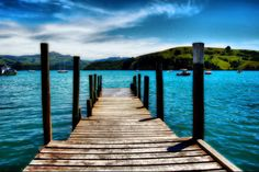A beautiful view of an old wooden dock in New Zealand.