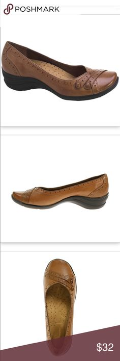 """NEW Hush Puppies Burlesque Tan Leather Shoes 7 Perforations, buttons and artisan details accent this fashionable slip-on that has exceptional comfort. UPPER/LINING  • Hand-burnished, full grain leather uppers • Artisan stitching and fashion details are combined to create unique yet classic styling  • Breathable microfiber linings  MIDSOLE/OUTSOLE  • Zero G® technology provides light weight comfort and exceptional flexibility  • 30 mm (1 1/4"""") molded wedge heel • Molded rubber outsole…"""