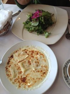 The most amazing ravioli dish served at Trellis Restaurant, Menlo Park, CA. Gorgonzola cheese in the ravioli and the sauce! Topped with almonds and finished in the broiler.