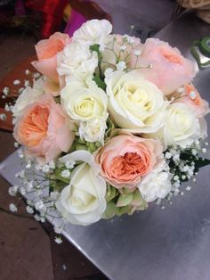 Peach and white rose wedding bouquet