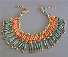 Beautiful Art Deco necklace from 1925. Ancient Egyptian style brass links with blue faience cylinder beads and coral glass cylinder beads. Brass spring clasp.