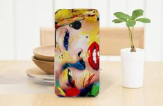 Using water color painting on canvas sheet you can make this artistic back cover for your phone at home.