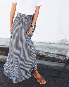 Casual striped maxi skirt with simple white tee and tan sandals.