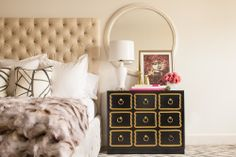 Sally Wheat Interiors Master bedroom, tufted bed, fur throw, Dorothy Draper chest, vintage round oversized mirror, pattern carpet